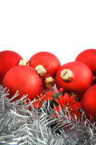 Red Christmas balls. With flower and silver decoration on white background royalty free stock photography