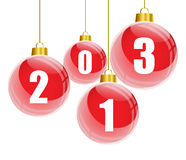 Red christmas balls with 2013 numbers. Red christmas balls with the numbers of new year 2013 hanging Stock Photo