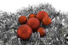 Red Christmas balls. Small and Big Christmas balls on a garland decoration Stock Images