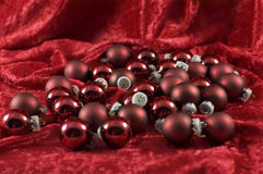 Red Christmas balls. Bunch of red Christmas balls gathered on red velvet Royalty Free Stock Photos