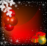 Red Christmas balls. Abstract colorful background with white fir branch, snowflakes and colored gift boxes Stock Images