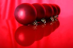 Red christmas balls. With reflections against on red Royalty Free Stock Photos