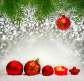 Red Christmas balls and Advent candle . Royalty Free Stock Photo