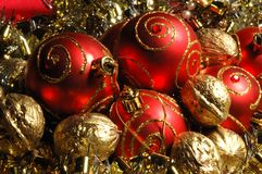 Red Christmas Balls And Golden Walnuts Royalty Free Stock Images