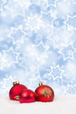 Red Christmas balls background decoration card with snow winter Stock Photography