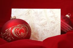 Red Christmas Balls with Blank Paper. Two Red Christmas Balls with Blank Embossed Paper Royalty Free Stock Photos