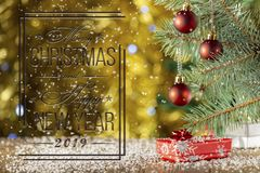 Red Christmas balls on blurred background. Christmas card. Falling snow. royalty free stock images