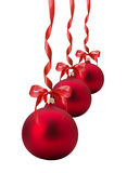 Red Christmas balls with bow isolated on the white background Royalty Free Stock Images