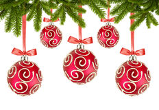 Red Christmas balls with bows and christmas tree branches on whi Stock Images