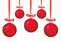Red Christmas balls with bows on white Royalty Free Stock Image