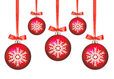 Red Christmas balls with bows on white Stock Photography