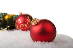 Red christmas balls with branch of christmas tree. Red christmas balls with branch christmas tree on snow Royalty Free Stock Photos