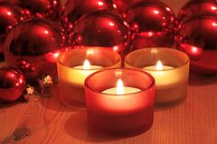 Red Christmas balls and candles stock photography
