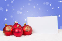 Red Christmas balls card for wishes with copyspace Royalty Free Stock Photos