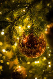 Red christmas balls with christmas tree stock photography