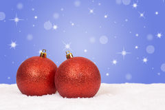 Red Christmas balls decoration with snow and snowflakes Stock Photos