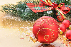 Red Christmas balls on festive background. Red Christmas balls on golden festive background Stock Image