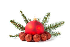 Red Christmas balls and fir branch Royalty Free Stock Photo