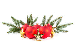 Red Christmas balls and fir branch Stock Images