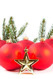 Red Christmas balls and fir branch Stock Photography