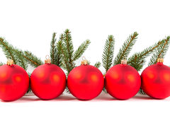 Red Christmas balls and fir branch Royalty Free Stock Photos