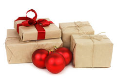 Red Christmas balls and gifts boxes closeup Royalty Free Stock Photos