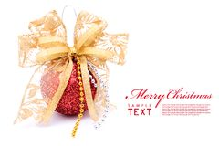 Red christmas balls and gold bow ribbon Stock Image