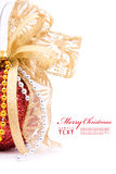 Red christmas balls and gold bow ribbon. On white background with copy space royalty free stock photography