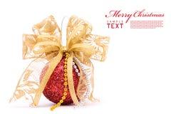 Red christmas balls and gold bow ribbon Stock Photo