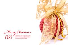 Red christmas balls and gold bow ribbon Royalty Free Stock Photos