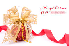 Red christmas balls and gold bow ribbon. On white background with copy space stock photography