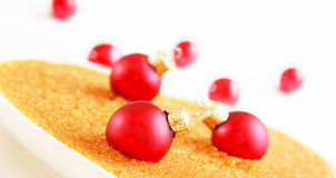 Red christmas balls on gold Stock Photography