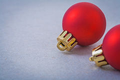 Red christmas balls on gray background with copyspace Royalty Free Stock Photography