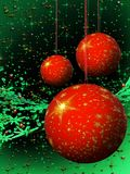 Red Christmas balls on green background Stock Photos