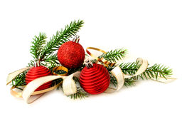 Red Christmas balls and green branch stock images