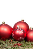 Red Christmas balls on green fir tree branch Stock Photography
