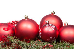 Red Christmas balls on green spruce branch royalty free stock images
