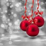 Red Christmas balls on the grey background Royalty Free Stock Photos