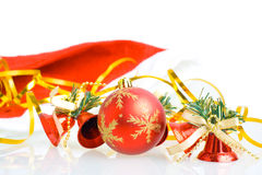 Red Christmas balls and hand bells. Isolated on white background Stock Images