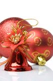 Red christmas balls and handbell. S on a white background Royalty Free Stock Photography