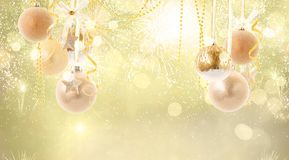 Red christmas balls. Hanging golden christmas balls on golden bokeh background with copy space royalty free stock photo