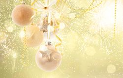 Red christmas balls. Hanging golden christmas balls on golden festive background with copy space royalty free stock image