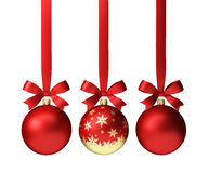Red christmas balls hanging on ribbon with bows, isolated on white royalty free stock photography