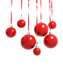 Red Christmas balls hanging on ribbons isolated Stock Photo