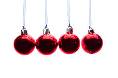 Red christmas balls hanging in a row on white background Royalty Free Stock Photos