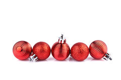 Red christmas balls horizontally on straight line Royalty Free Stock Photo