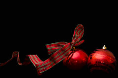 Red christmas balls isolated on a black background Stock Photo