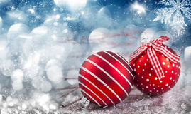 Red Christmas balls over sparkling holiday background Royalty Free Stock Photography