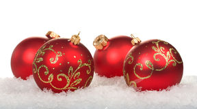 Red christmas balls with pattern. On snow on white background Royalty Free Stock Photos