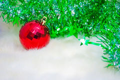 Red Christmas balls on pink wool Stock Photo